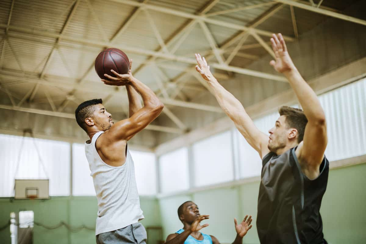 A couple of men playing basketball