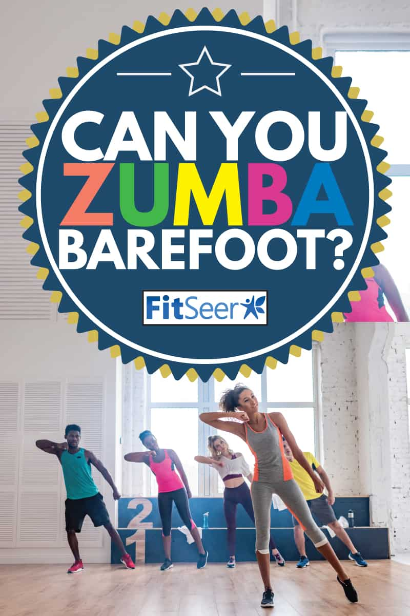 Can You Do Zumba Barefoot (Including On A Carpet), Smiling african american trainer performing zumba with multicultural dancers in dance studio