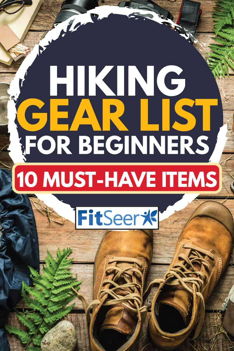 Backpack, jacket, boots, belt, thermos and camera on wooden background captured from above, Hiking Gear List For Beginners