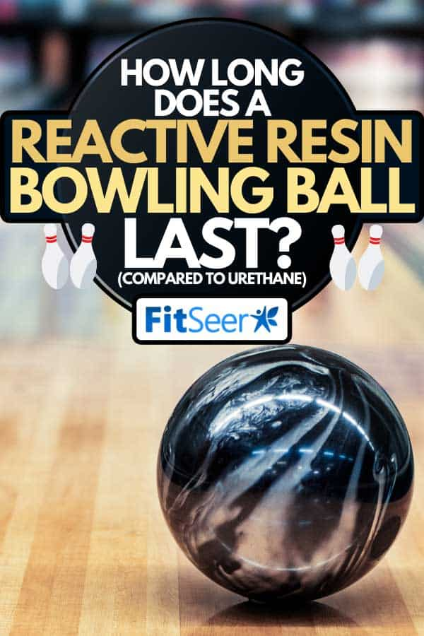 Black and silver bowling ball rolling down the lane, How Long Does A Reactive Resin Bowling Ball Last? (Compared To Urethane)