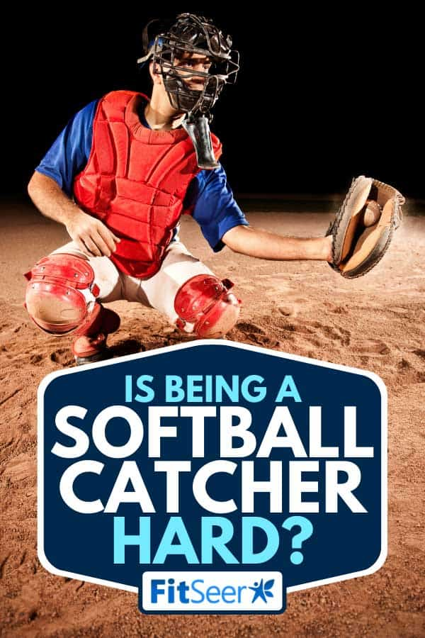Softball catcher in action catching a ball at home plate, Is Being A Softball Catcher Hard?
