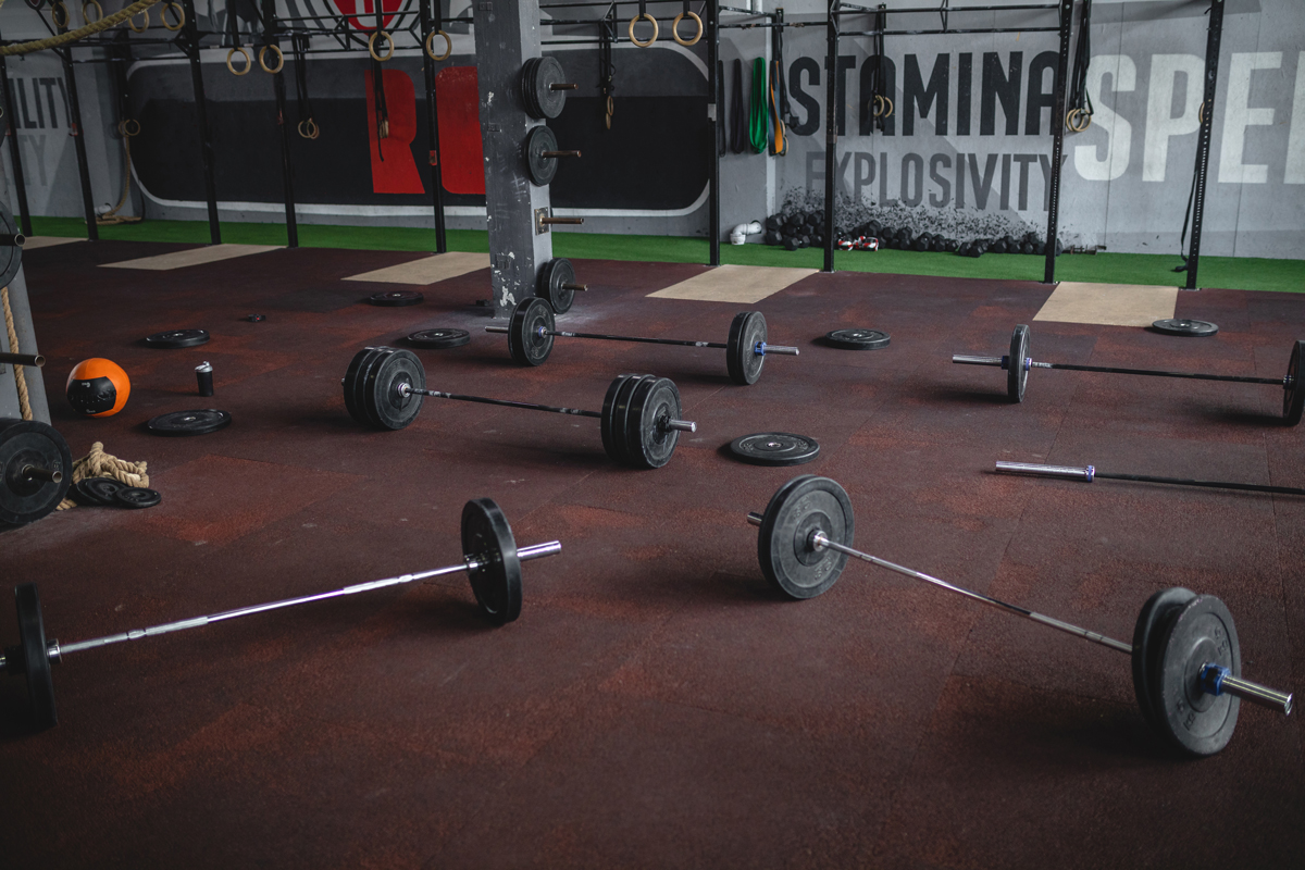 Sets of weightlifting equipment's placed on the floor of a gym