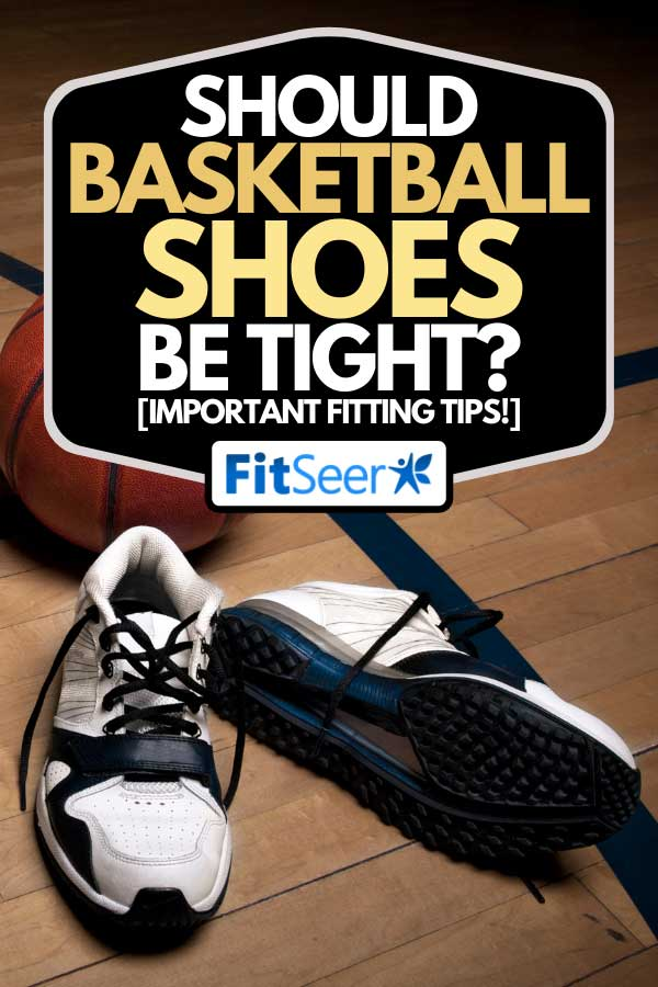 Basketball court floor with a ball and athletic shoes, Should Basketball Shoes Be Tight? [Important Fitting Tips!]