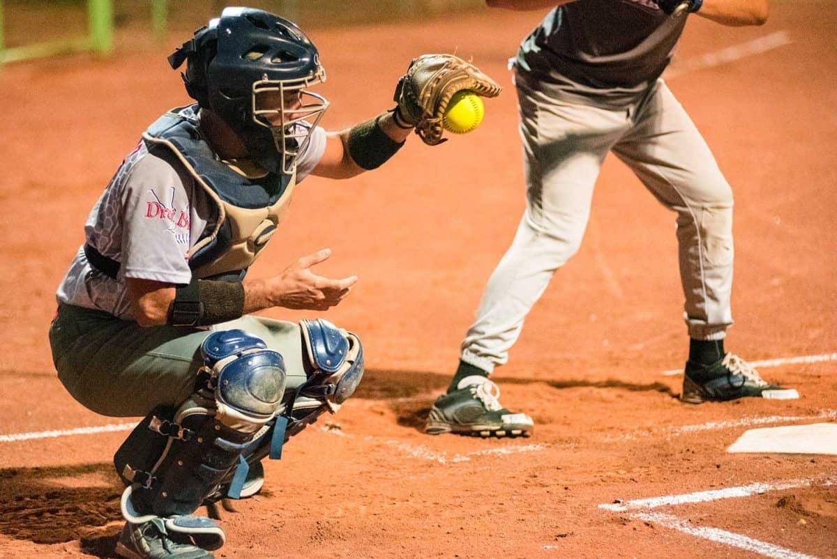 Softball catcher catching the ball