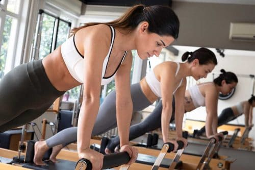 Read more about the article How Long Should A Pilates Session Be [And How Often To Do Them]