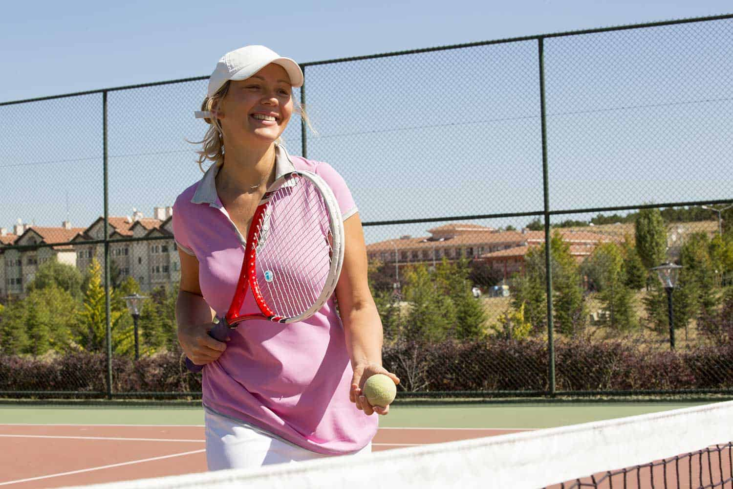 Young female tennis player playing tennis