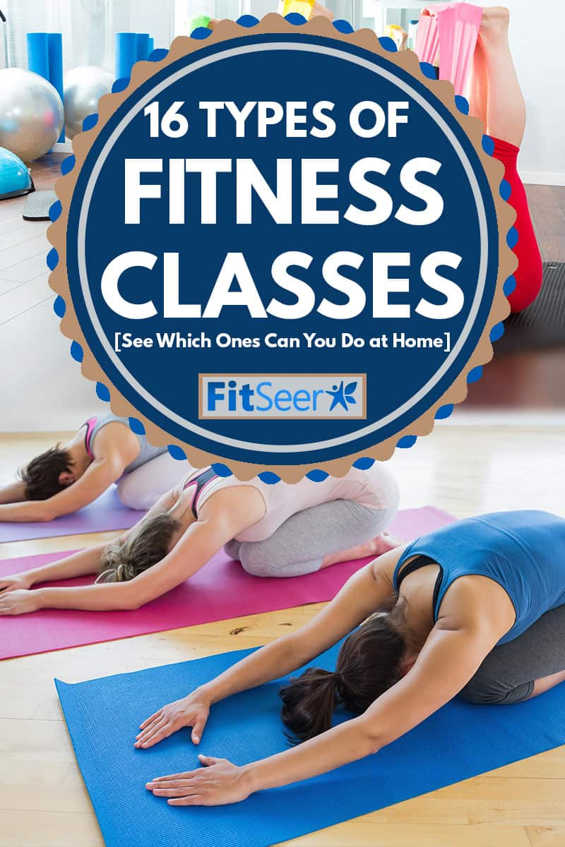 Aerobics-pilates-women-with-rubber-bands-in-a-row,-Women-doing-childs-pose-in-yoga-class,-16-Types-of-Fitness-Classes-[See-Which-Ones-Can-You-Do-at-Home]