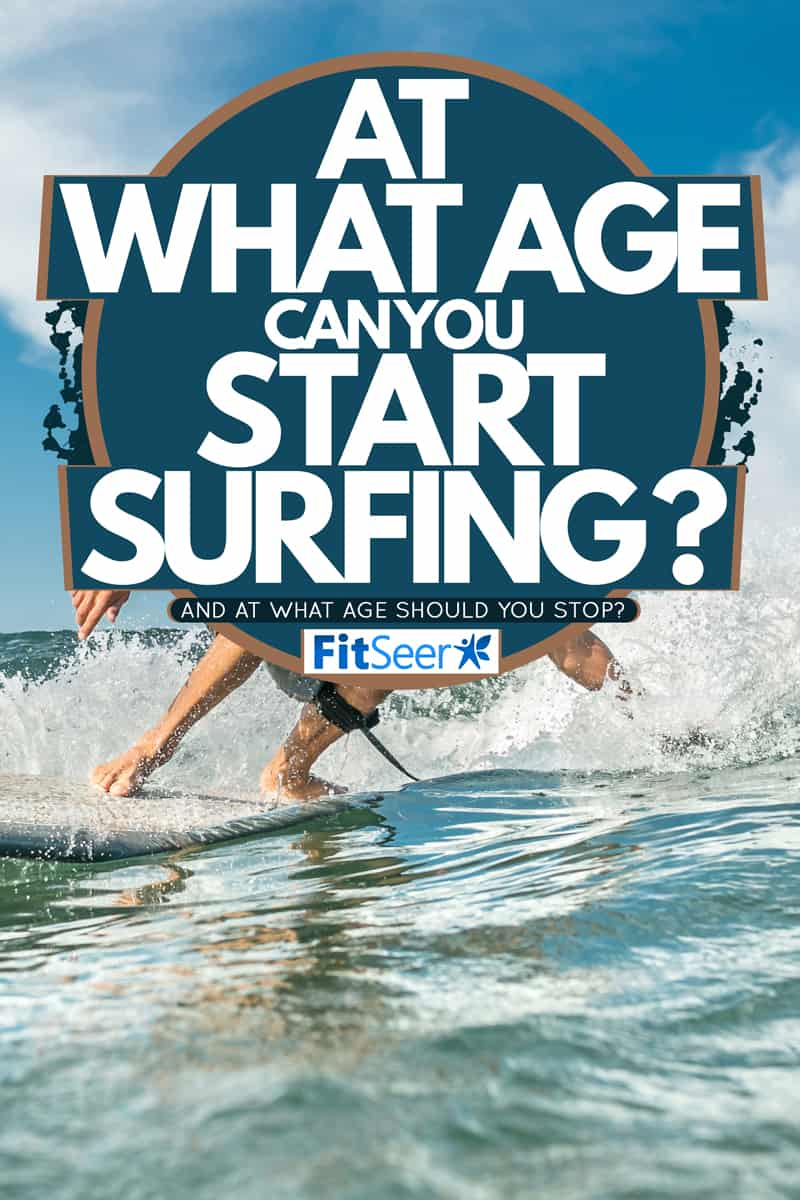 A surfer wearing a white shirt and Aloha pants riding the waves of a blue ocean, At What Age Can You Start Surfing? [And At What Age Should You Stop?]