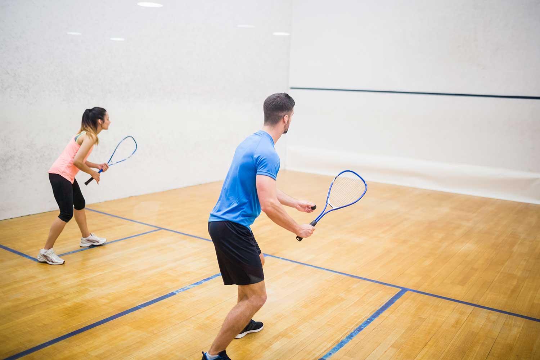 Couple enjoying a game of squash