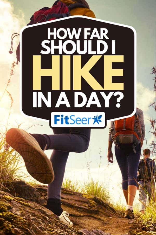 Hikers walking on a hiking trail in mountains, How Far Should I Hike In a Day? [Typical Numbers Revealed]