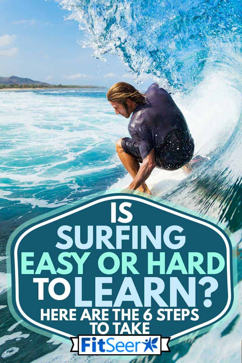 Surfer on blue ocean wave in the tube getting barreled, Is Surfing Easy or Hard to Learn? [Here Are the 6 Steps to Take]