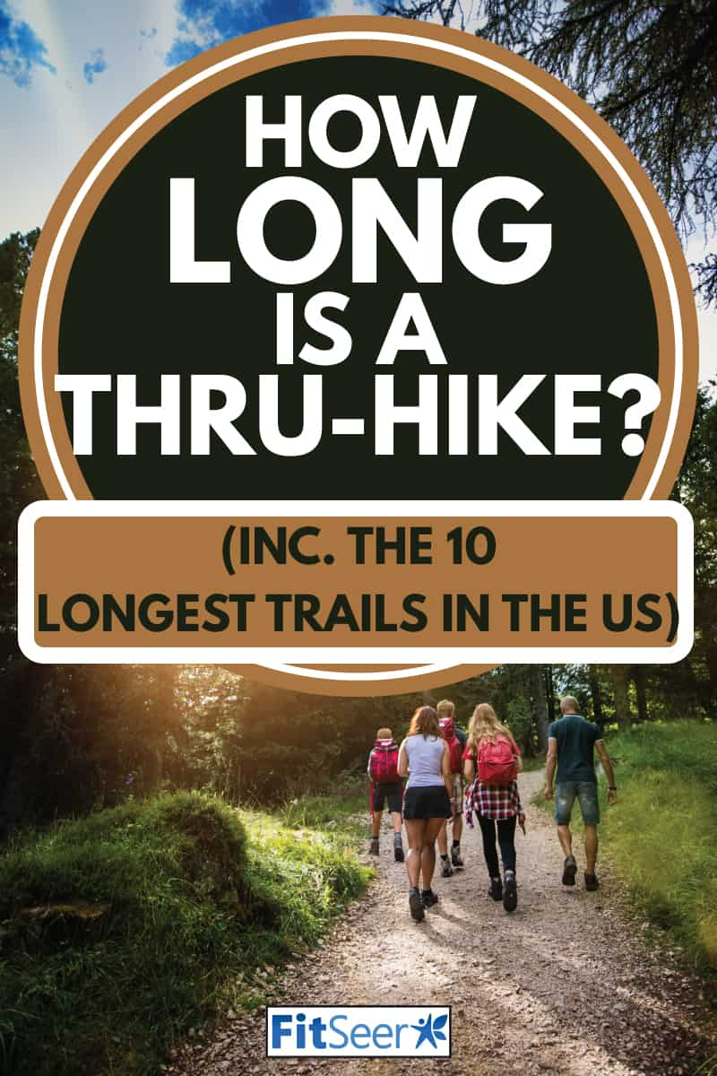 family having a thru-hike in a clearing in the wilderness, How Long Is a Thru-Hike [inc. the 10 longest trails in the US]