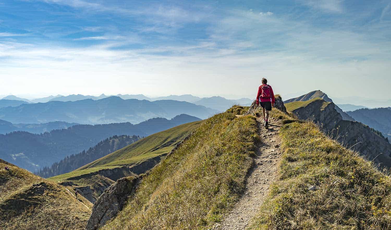 Senior woman hiking in fall, autumn on the ridge