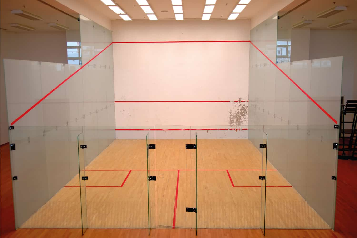 A standard squash court, photo taken from outside the back wall