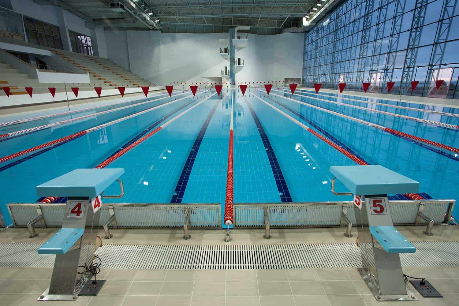 An empty Olympic swimming pool