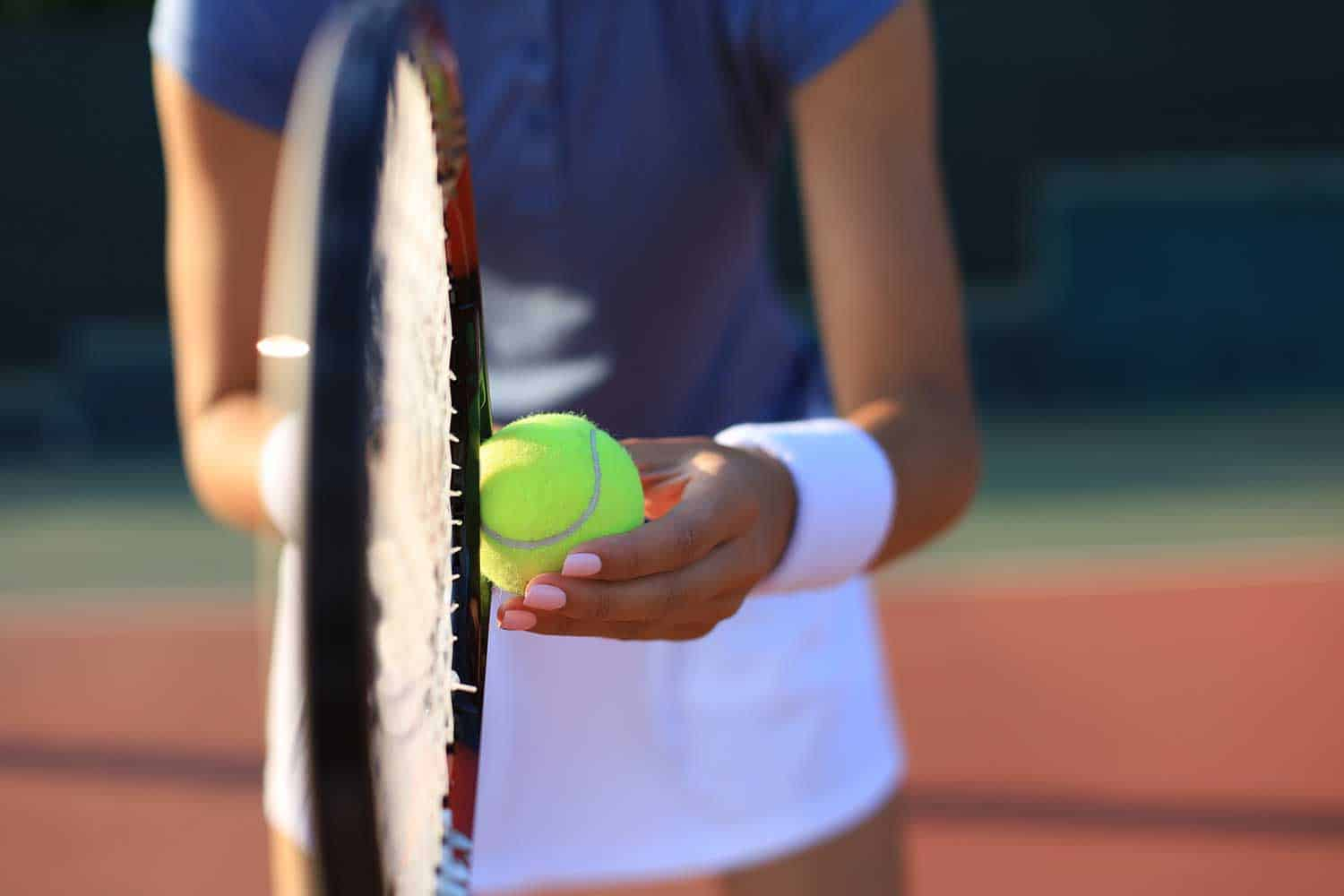 Close up of a tennis player hitting the ball with racket