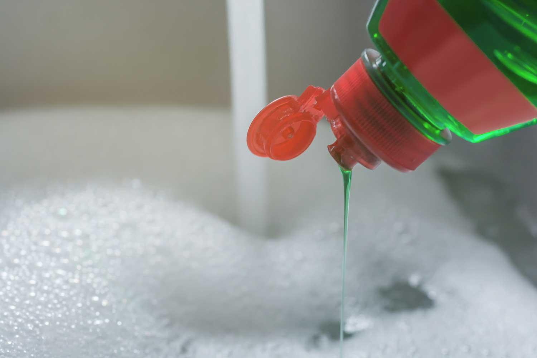 Dishwashing detergent poured in kitchen sink