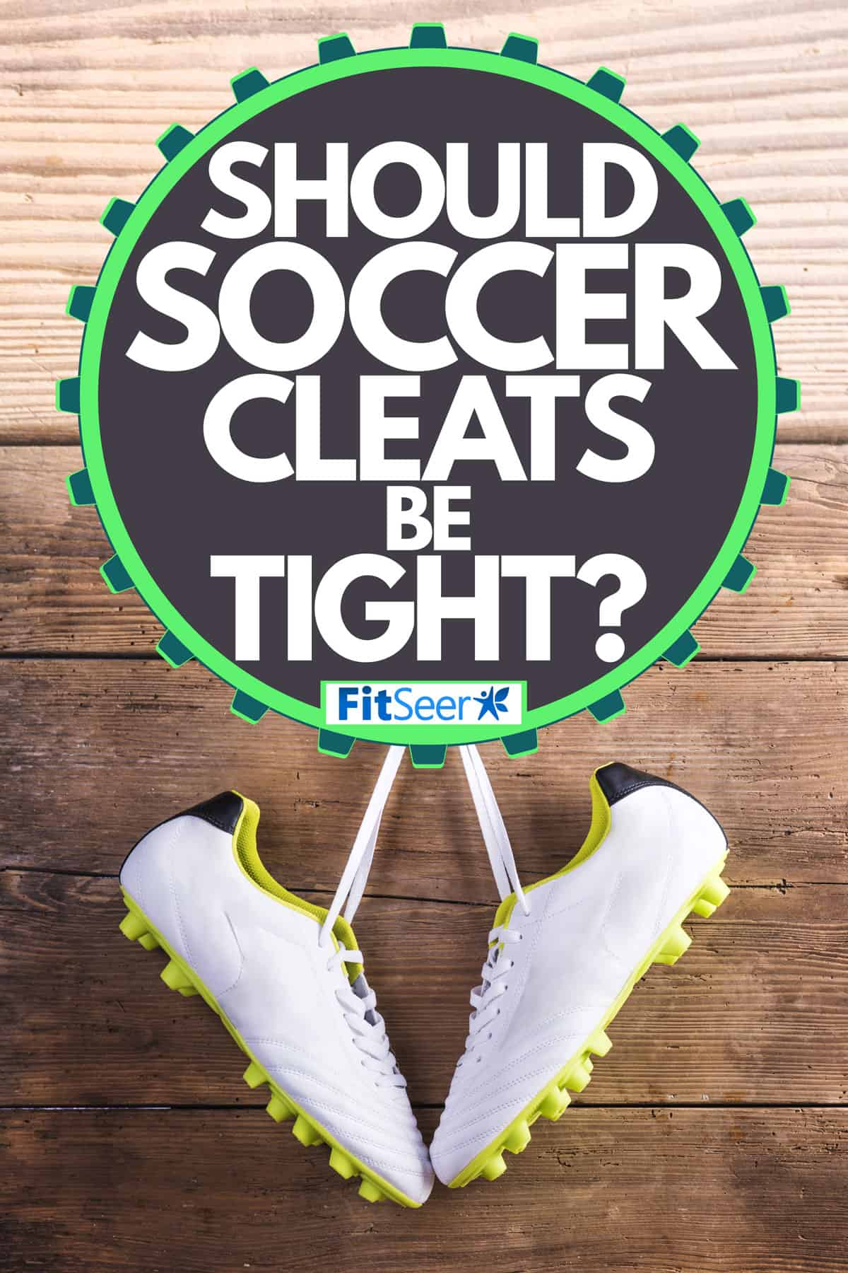 A clean pair of soccer cleats hanging on a wooden wall, Should Soccer Cleats Be Tight?