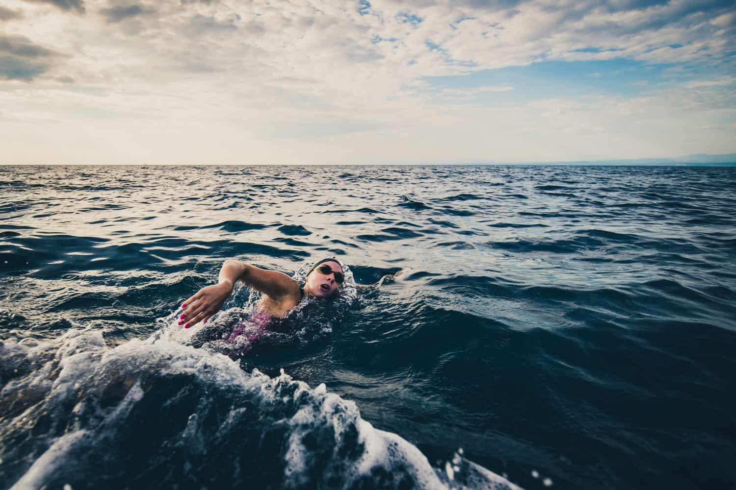 An open sea swimming athlete swimming on open waters