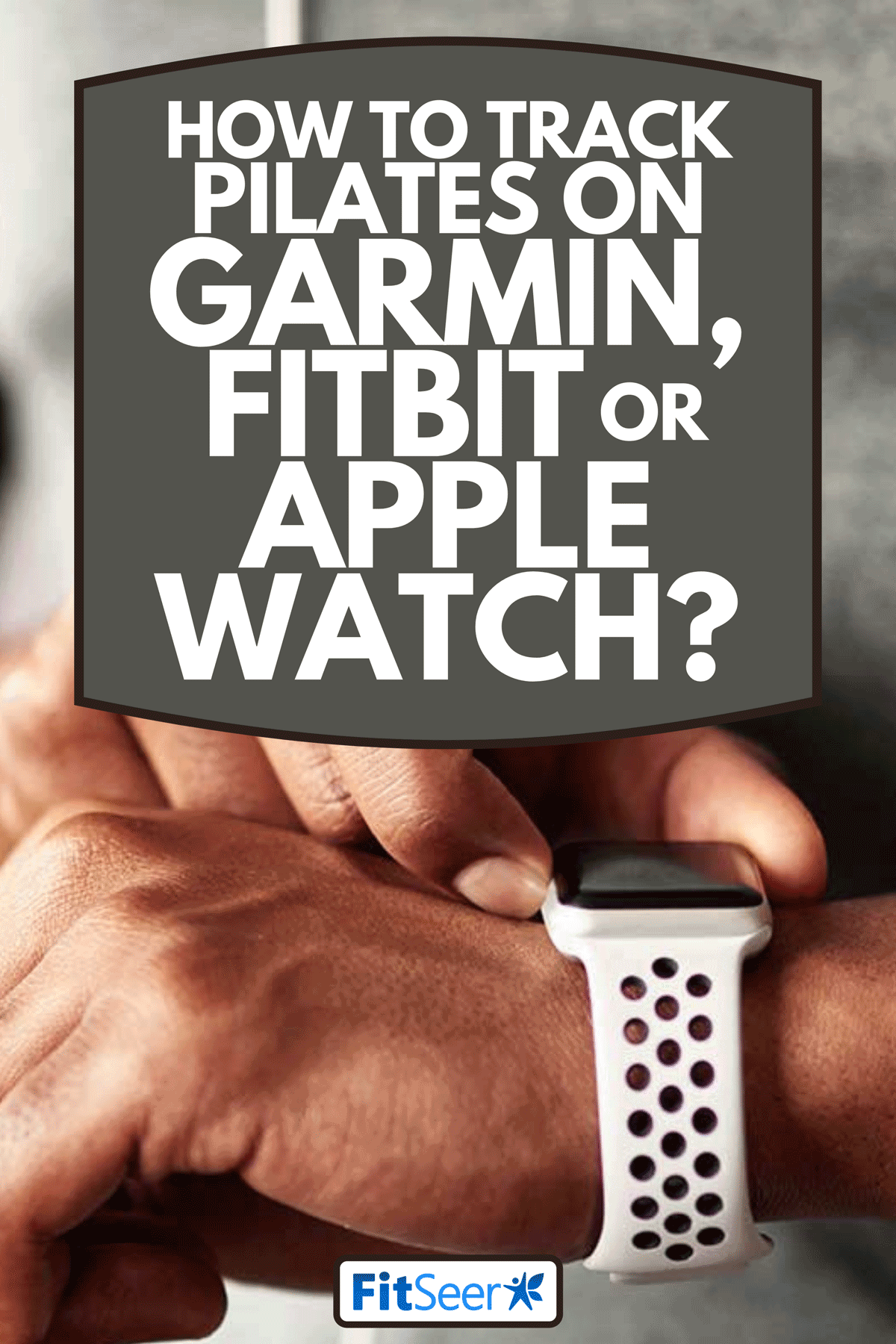 A man using his wristwatch for tracking activity, How To Track Pilates On Garmin, Fitbit Or Apple Watch?