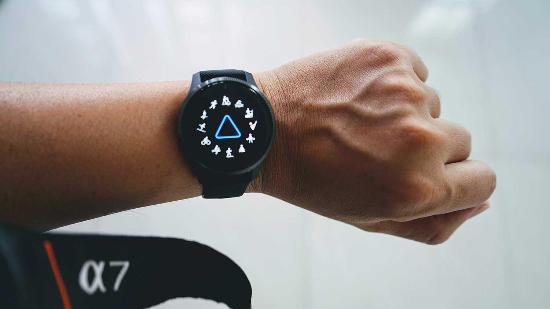 Person wearing smart watch Garmin Venu
