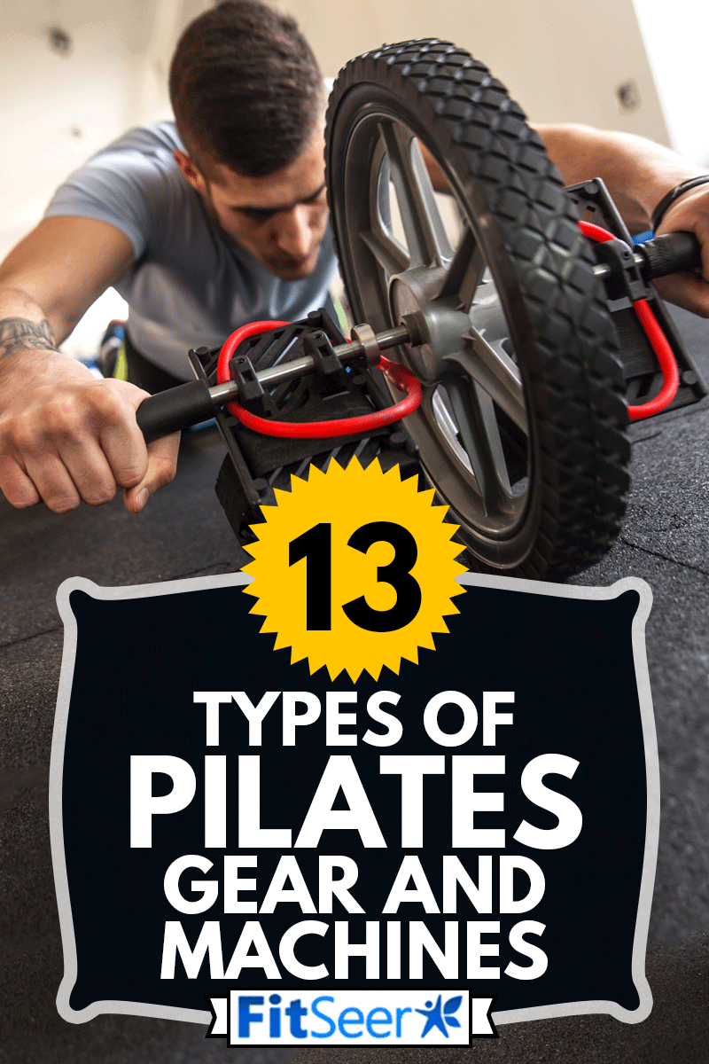 Man doing pilates and working on his abs with a ab roller at the gym, 13 Types Of Pilates Gear And Machines