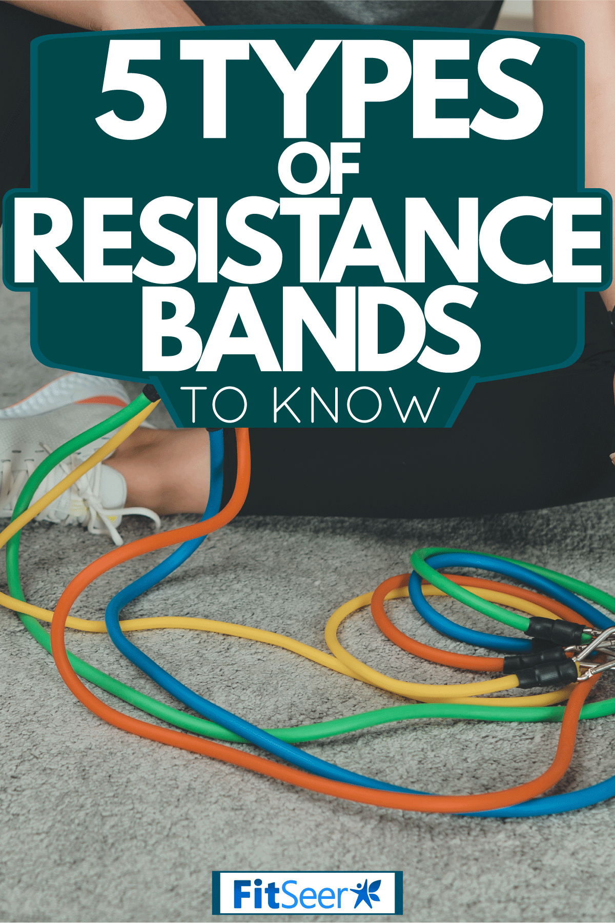 A woman taking a break from using resistance bands on her workout, 5 Types Of Resistance Bands To Know