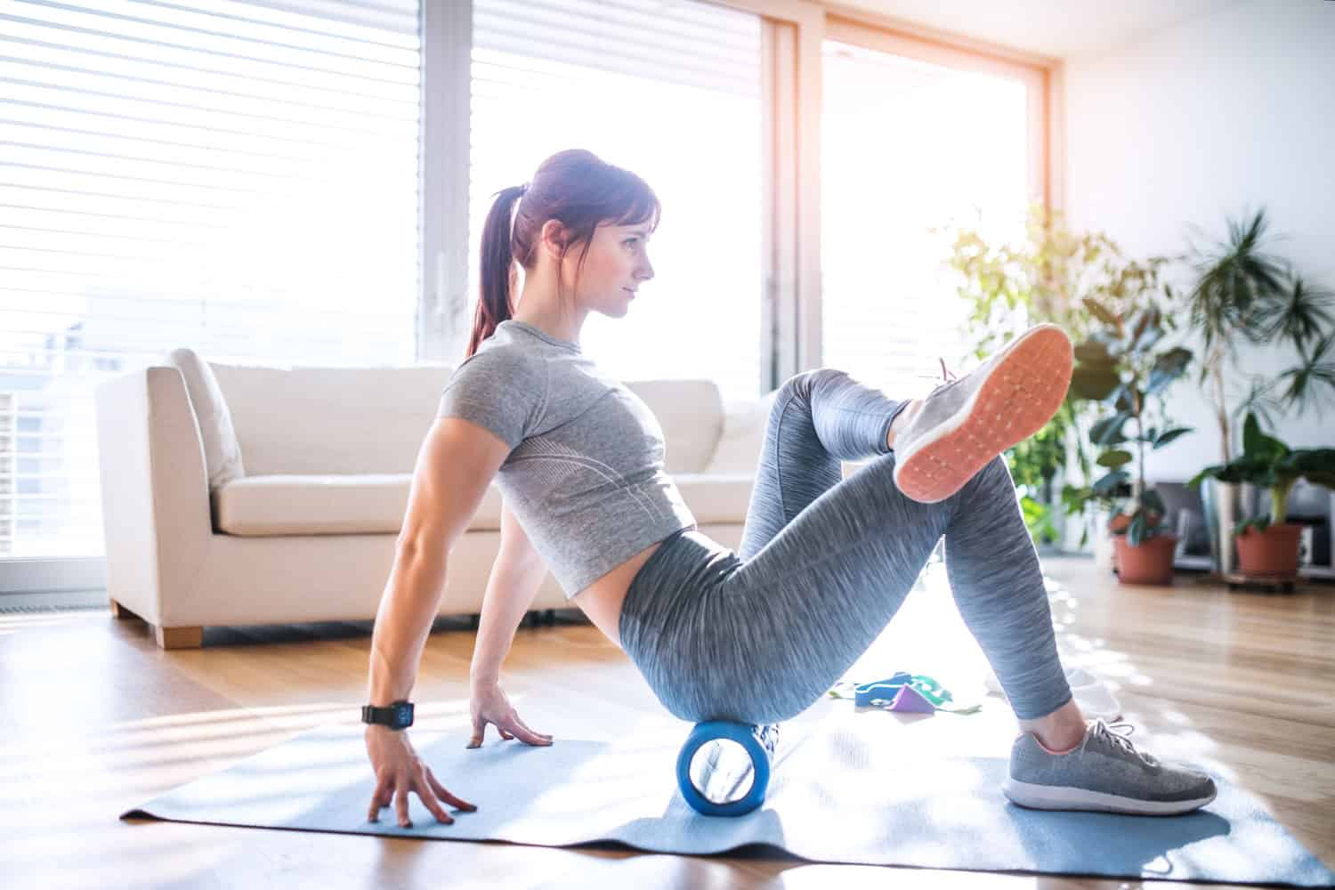 A woman stretching before doing some home workout