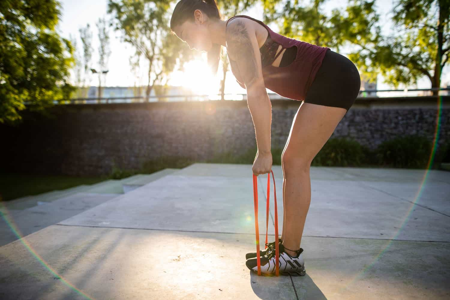 A woman working out using a resistance band outside