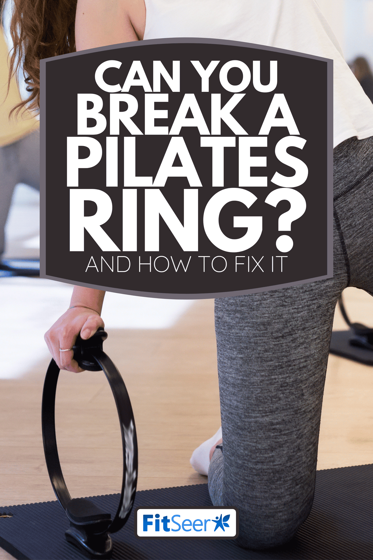 Woman practicing Pilates with ring at group class in yoga studio, Can You Break A Pilates Ring? [And How To Fix It]