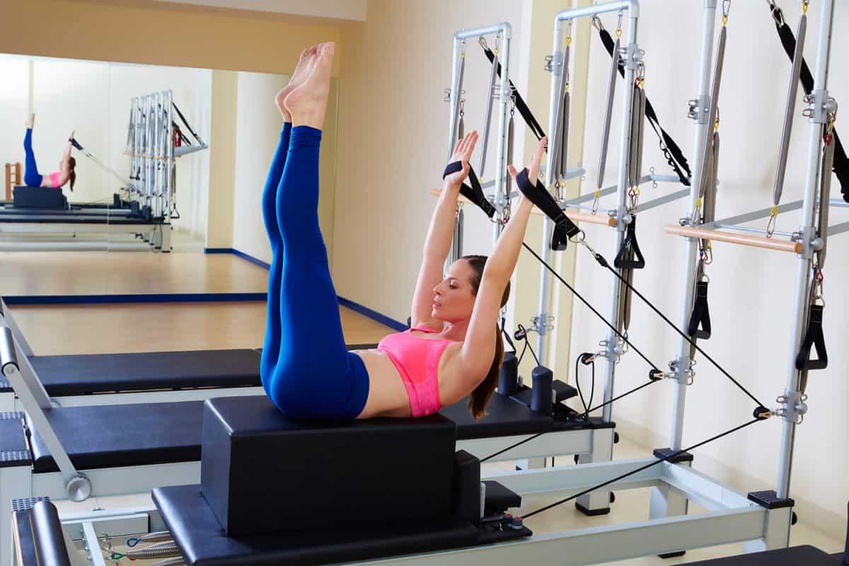 Pilates reformer woman back stroke exercis
