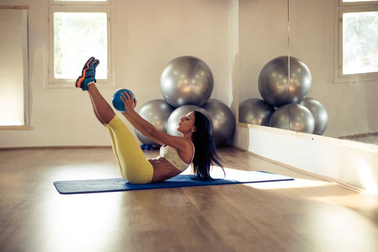 Staying in shape, woman holding an overball