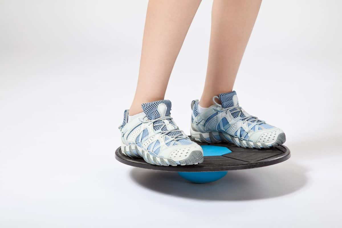 Woman maintaining balance on Wobble Board