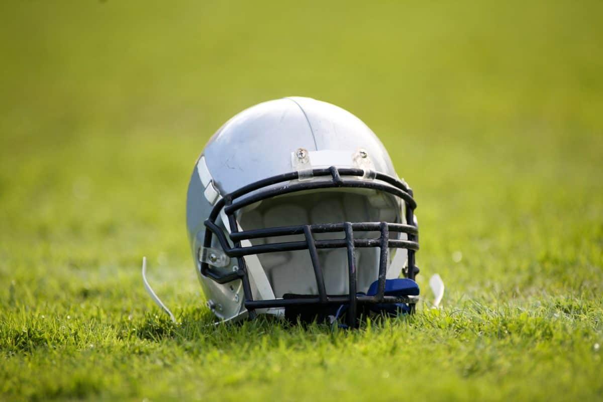 An American footballers helmet left on the grass