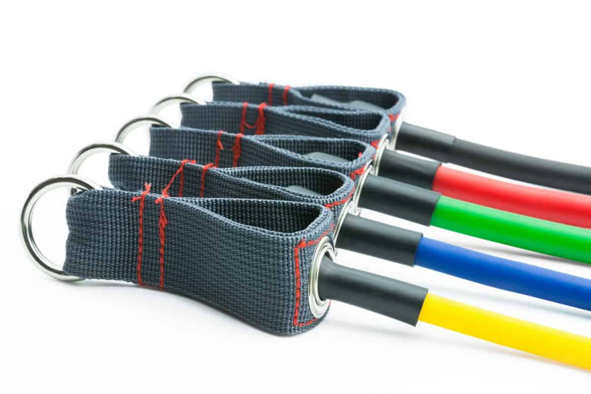 Different colored resistance bands on a white background