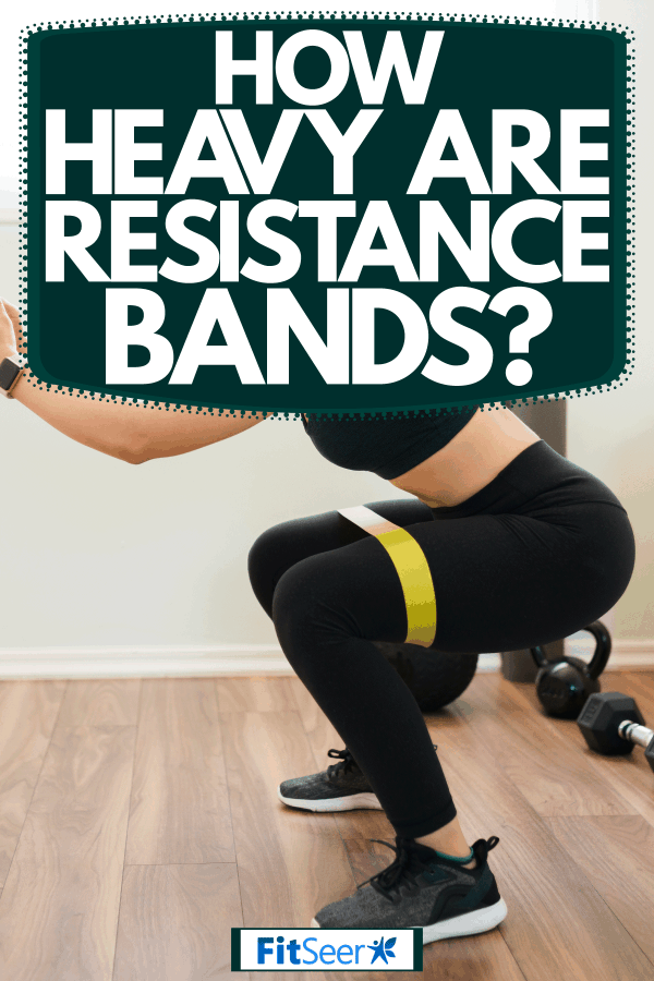 A young woman doing her resistance band workout inside her home, How Heavy Are Resistance Bands?