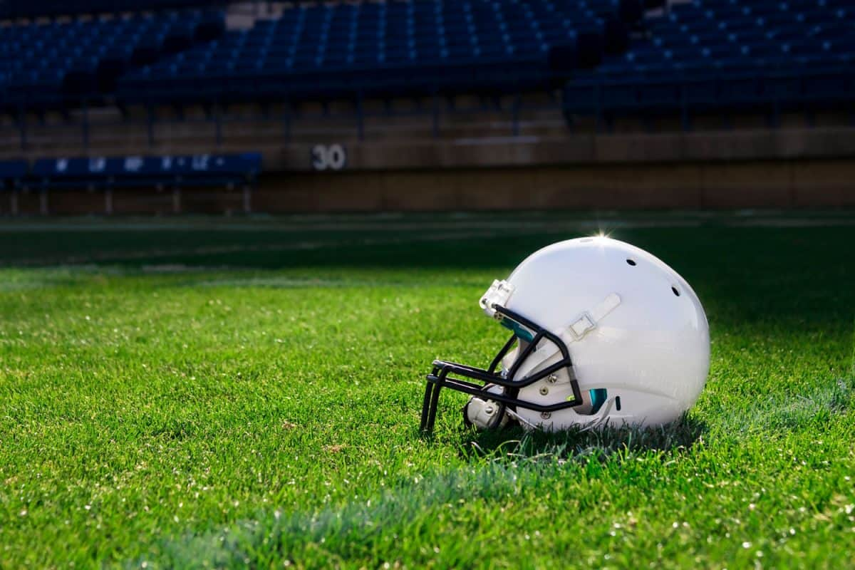 A white football helmet on the middle of the field