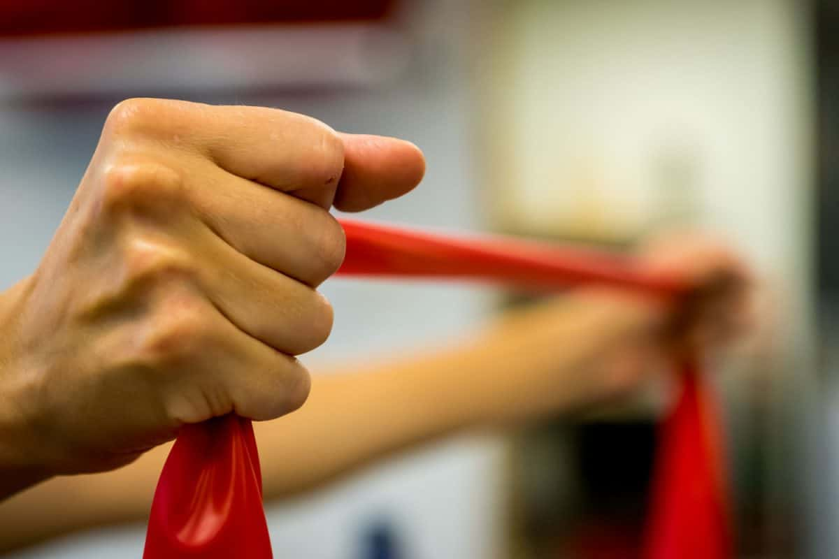 A woman stretching a resistance band