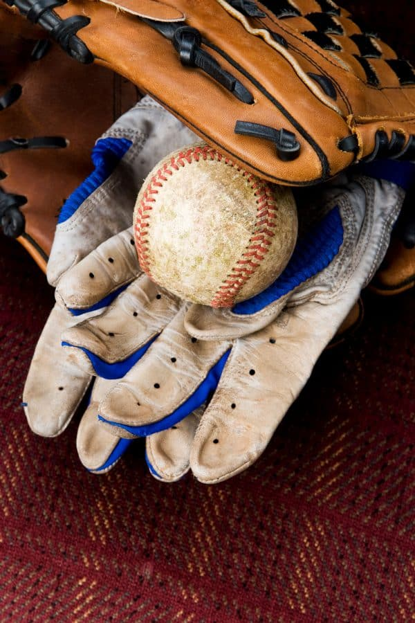Baseball gloves and a baseball