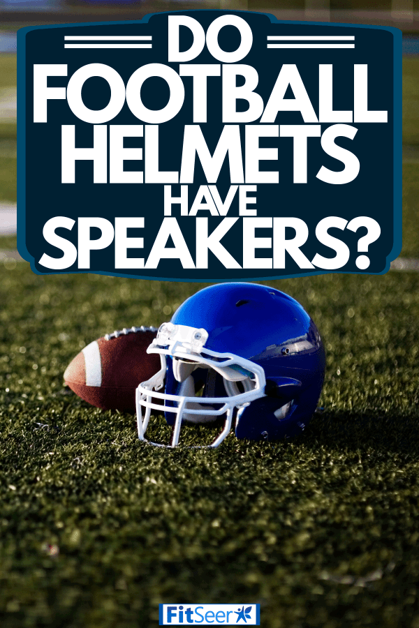 A blue colored football helmet and a football on the side left on the field, Do Football Helmets Have Speakers?