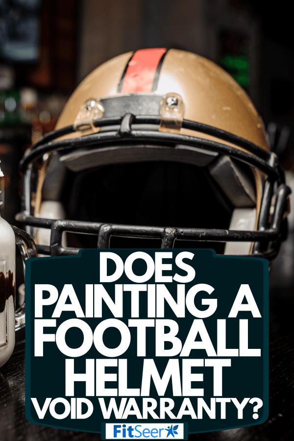 A football helmet on top of a bar table, Does Painting A Football Helmet Void Warranty?