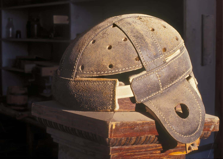 A dusty helmet on display