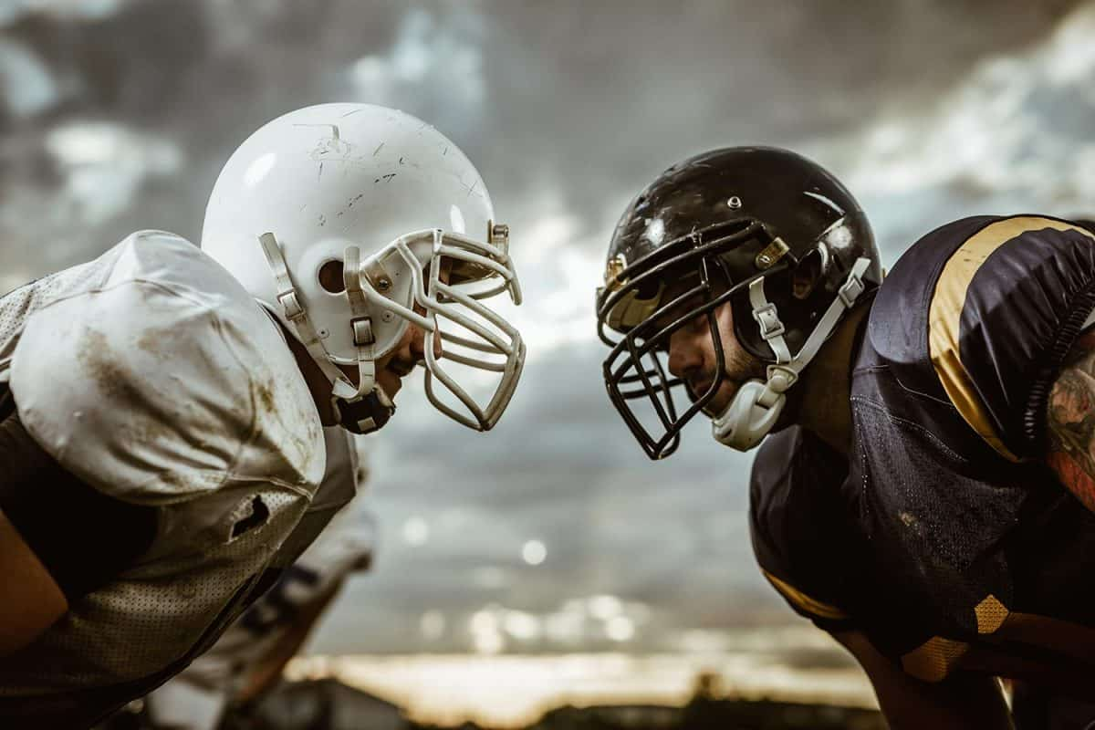 Two American football players looking at each other on a beginning of the match