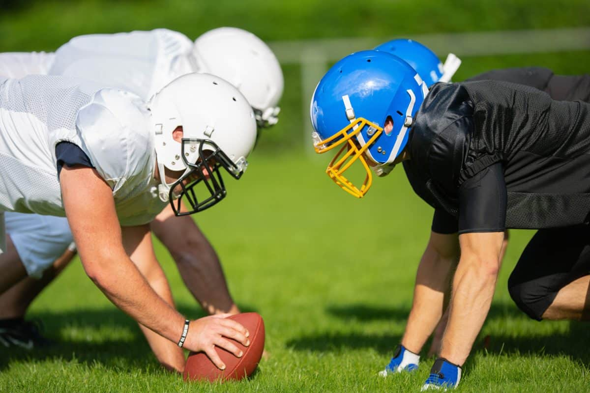 American Football Players lining up head to head, taking their positions. American Football Player and Cheerleader Series.