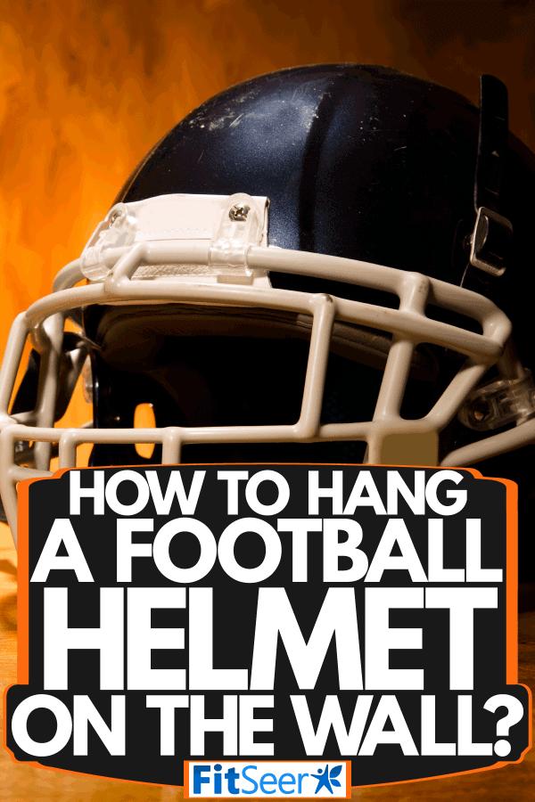 A football helmet on a table, How To Hang A Football Helmet On The Wall