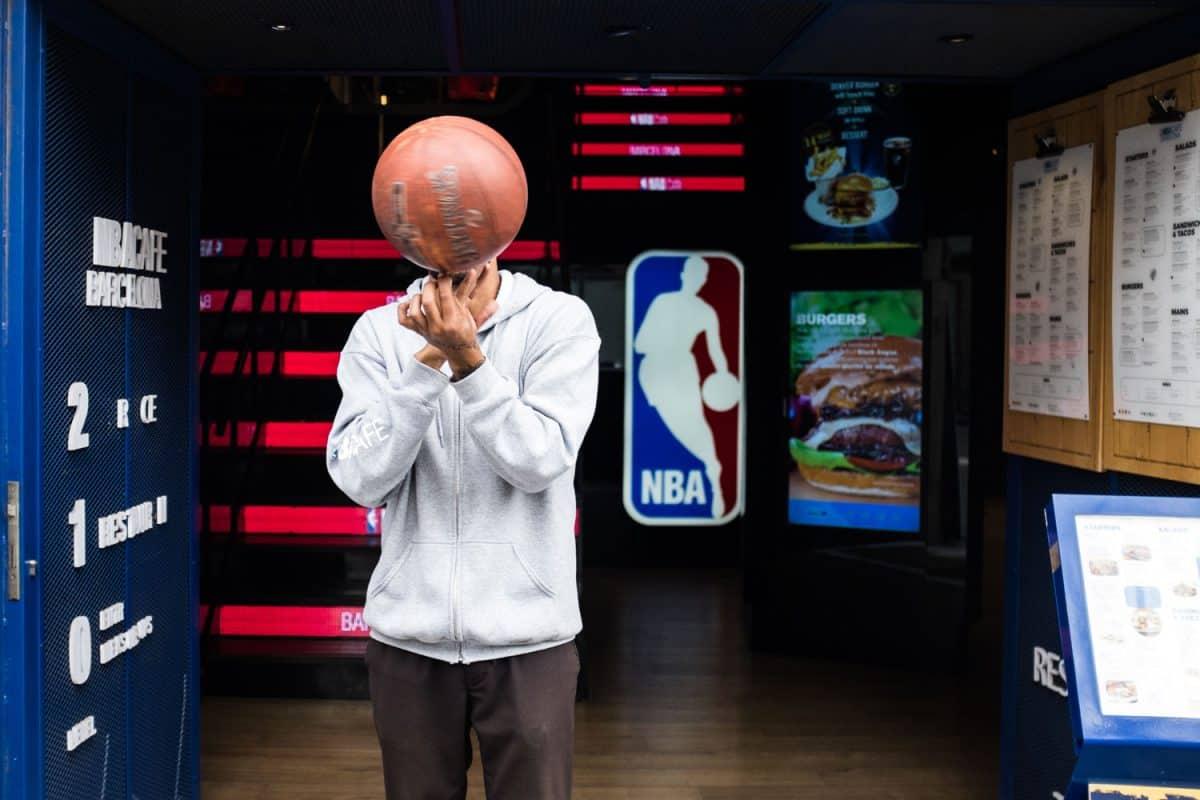A basketball player spinning a basketball