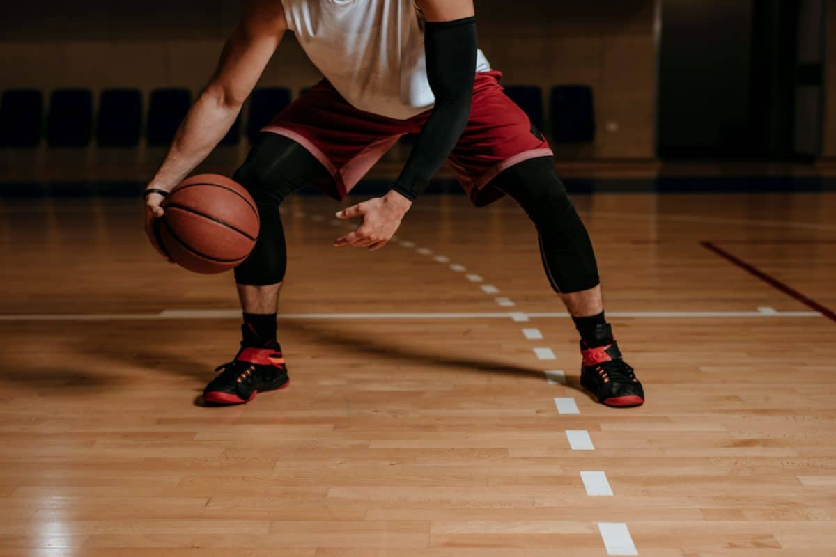 A basketball player training for his tournament, Do Arm Sleeves Help You Shoot Better In Basketball?