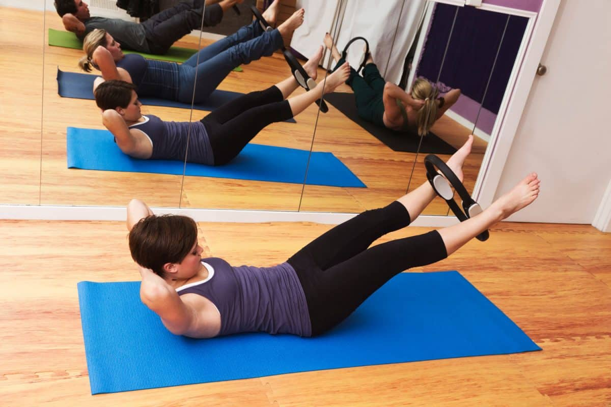 A group of fitness student doing some pilates workout