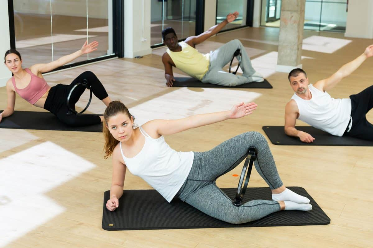 A group of women doing pilates workout