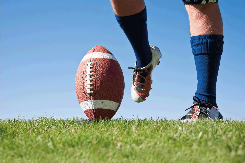 American Football Kickoff close-up photo. Athlete ready to kick the ball.